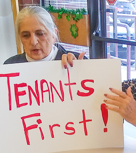 "Billie McGregor with poster ""Tenants First!"""