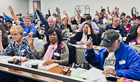 Tenant leaders raise hands to testify on bullying where they live